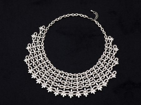 platinum: Close-up image of an expensive silver necklace on a dark background Stock Photo