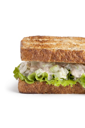 cropped image: Cropped image of an egg sandwich with lettuce leaf isolated on a white background