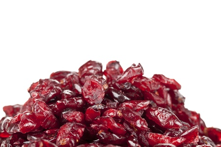 Close up image of heap of dried cranberries against white background