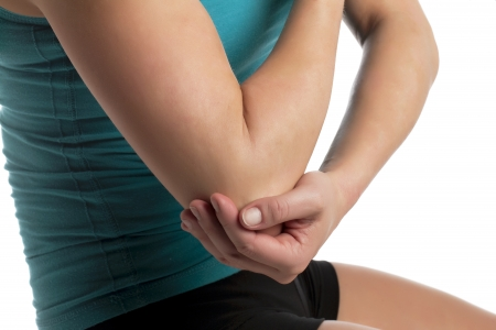 Human elbow suffering from pain in a close-up image Stock Photo