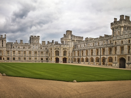 A courtyard at Windsor castle with very well kept grass on the outskirts of London, England.