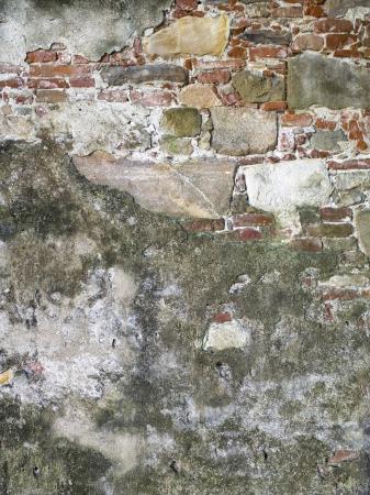 Close-up beeld van een oude verweerde gemetselde muur. Stockfoto