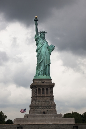 female likeness: Image of Statue of Liberty with cloudy sky in background.