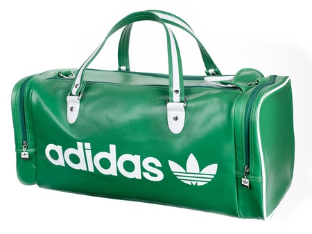 duffel: A green Adidas duffel bag with white accents