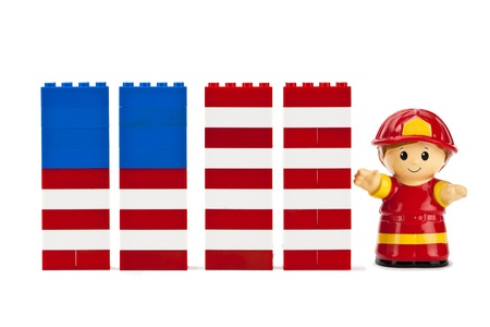Lego assembled into USA flag and a fire fighter mini-figure on the side