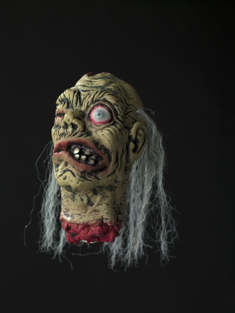 Image of a cockeyed demon against black background. Stock Photo - 17322174