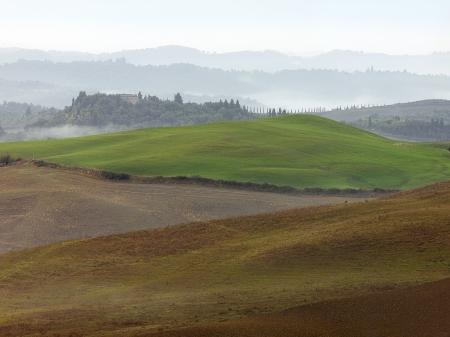 Glooiende weilanden, in Toscane. Stockfoto