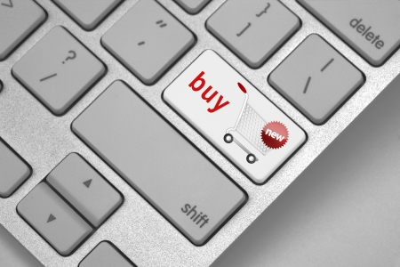 Icon of a shopping cart on the return key suggesting Buy Now! Stock Photo