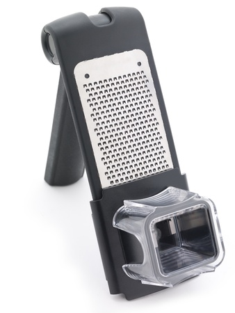 grate: Cheese grater standing with garlic press attachment.