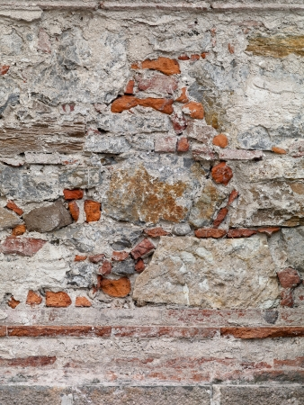 A light gray stone colored wall with an interesting pattern of red bricks Stock Photo - 17324365