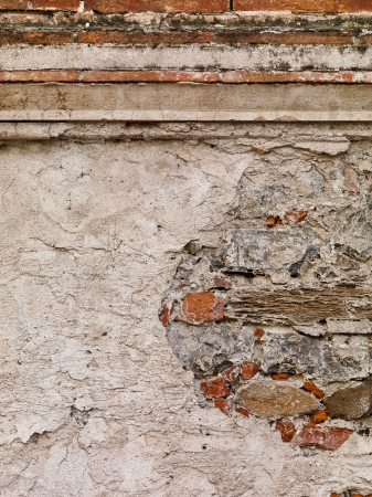 European wall hundreds of years old with cement stucco broken away to reveal the ancient wall underneath. Stock Photo - 17324367