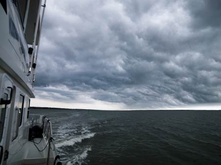 Epic clouds forming over water.