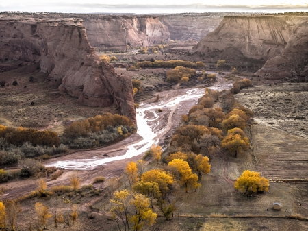 Elevated shot of cliffs and water stream surrounded with trees. Stock Photo - 17339296