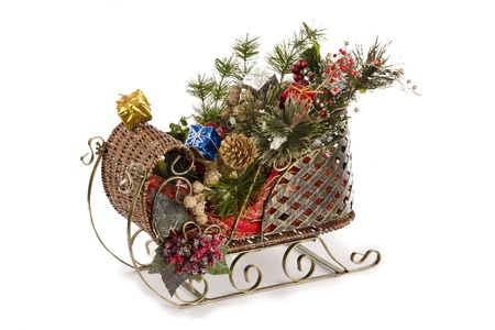 goodies: Isolated christmas sleigh with goodies against white background