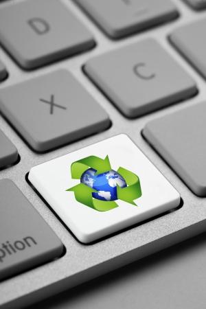 Closeup of computer keyboard keys emphasizing the key recycling Stock Photo - 17339573