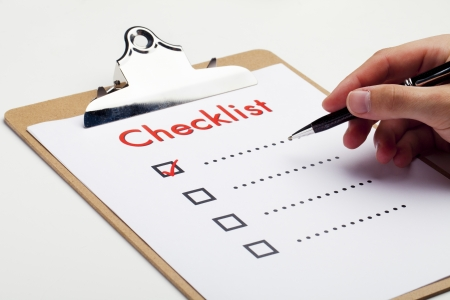 An item on a checklist being checked off Stockfoto