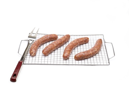 Sausages placed on a wire rack.