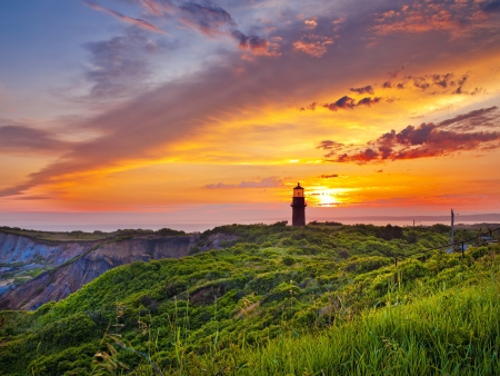 A lighthouse stands in front of a gorgeous sunset. Stock Photo - 17354098