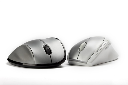mechanical mouse: Black and white computer mice on isolated white screen.