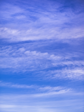 cirrus: This backdrop image is the most common form of high-level clouds are thin and often wispy cirrus clouds. Stock Photo