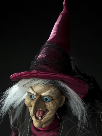 Close-up image of a witch over dark background. Stock Photo - 17352948