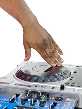 A hand of a dj scratching the vinyl on the turntable isolated on white
