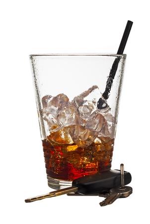 A half empty drink with a set of car keys sitting beside it