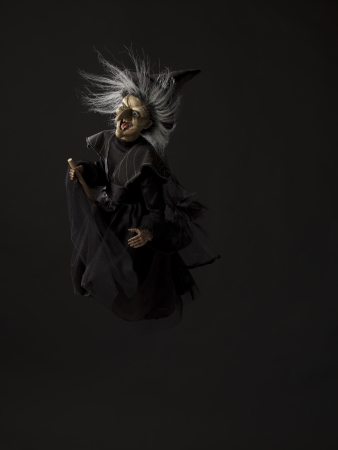 Image of a witch flying on her broomstick against dark background. Stock Photo - 17352197