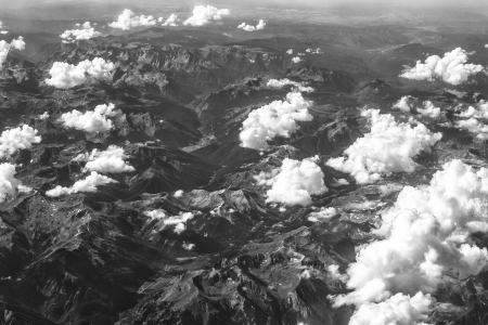 Black and white image of mountain view from airplane photo