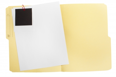 An opened folder with a blank sheet of paper and a blank photograph