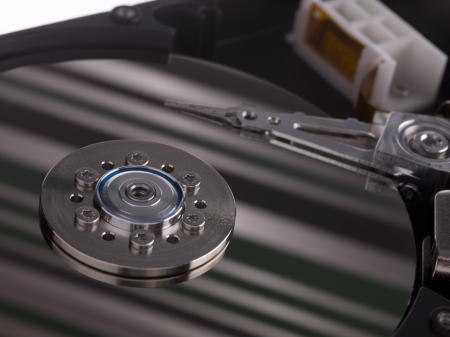 A hard drive with a pattern of stripes reflected across it Stock Photo - 17352027