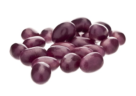 junk: Close-up image of purple round candies in a white surface