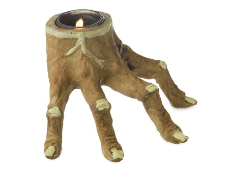 candle holder: Close-up image of a scary candle holder with lighted candle inside