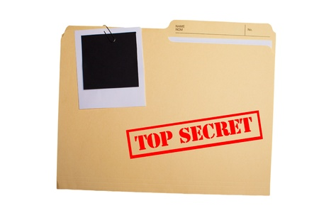 confidential: A folder with TOP SECRET stamped across the front and a blank photograph clipped to it
