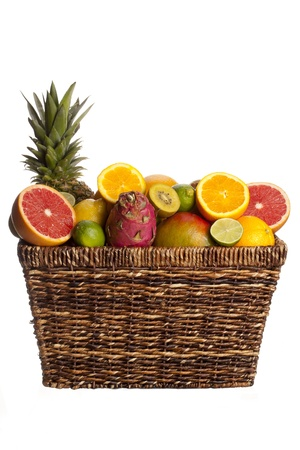 Variety of fruits in wicker basket over plain white background. Stock Photo - 17353064