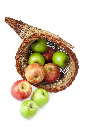 Close-up view of apples in wicker basket displayed over white background. Stock Photo - 17352953