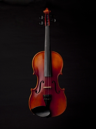 Classical violin isolated in a black background