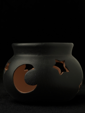 candle holder: Candle holder shaped like a witch pot