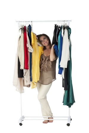clothes organizer: Portrait of a happy woman in the closet over the white surface Stock Photo