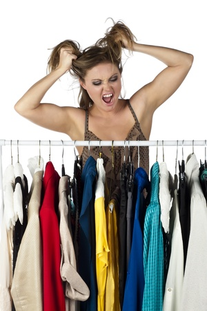 Close-up image of stressed shop owner looking at her clothes rack on a white surface Stock Photo - 17353135