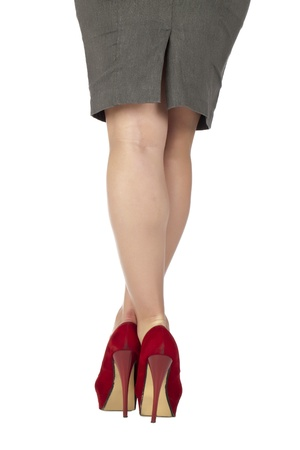 crossed legs: Closed up shot of a businesswomans legs taken from behind Stock Photo