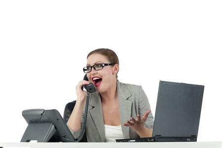 Enthusiastic businesswoman talking on phone Stock Photo