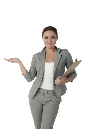 Portrait of businesswoman  presenting something standing against white background