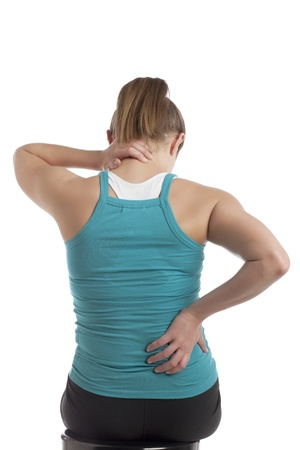 strenuous: Rear view of woman suffering from cervical spine pain