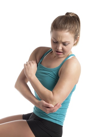 Portrait of sad woman suffering from elbow pain Stock Photo - 17352584