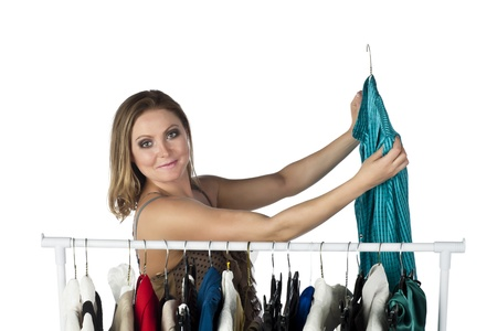Close-up image of female customer selecting clothes in the clothing rack photo