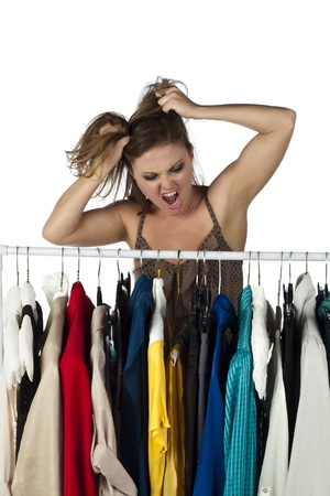 Frustrated woman finding it difficult to choose clothes from a clothes rack Stock Photo - 17352952