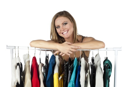 clothes organizer: Portrait of happy woman with her clothes collection against white background