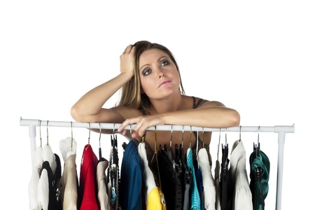 Portrait of a lonely woman leaning on a clothes rack Stock Photo - 17352074