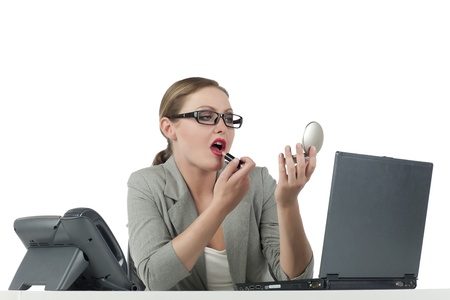 Young secretary applying lipstick over a white background Stock Photo - 17352215